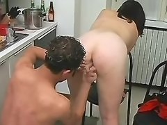 Masked couple make sex on kitchen