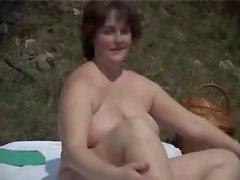 Plump mature woman solo in nature