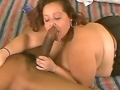 Depraved fatty mom plays with dick